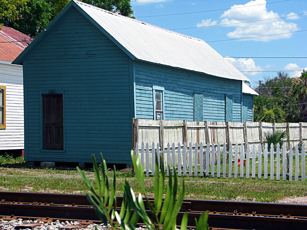 blue house train tracks picket fence ybor city tampa heidi suydam photographer simply our society